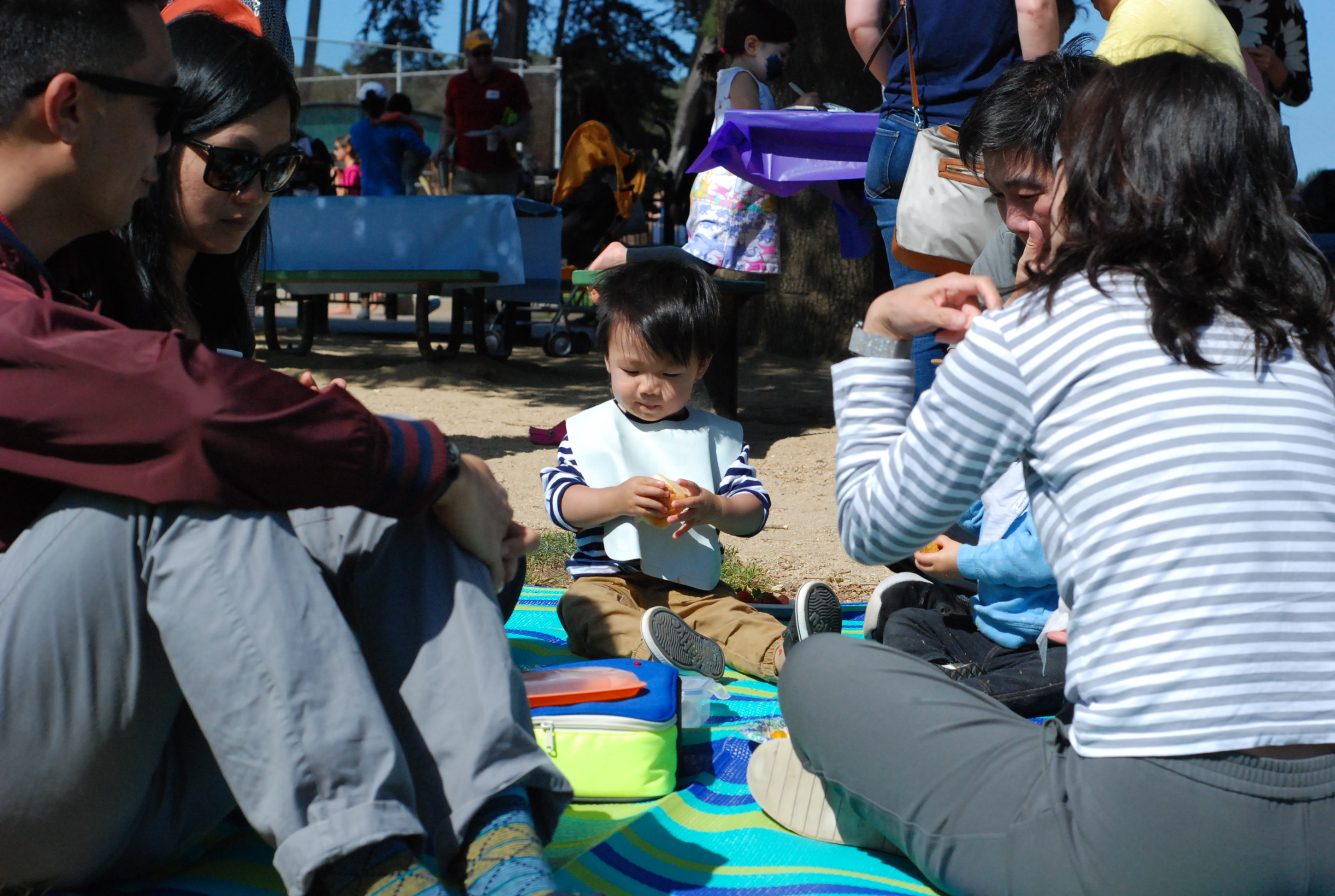 C5 families gather for food, socializing, play, games, and welcoming new families.