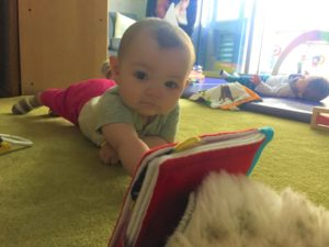 Infant interacting with a book